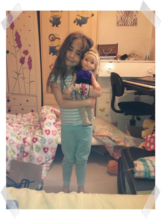 Ella hugging a doll