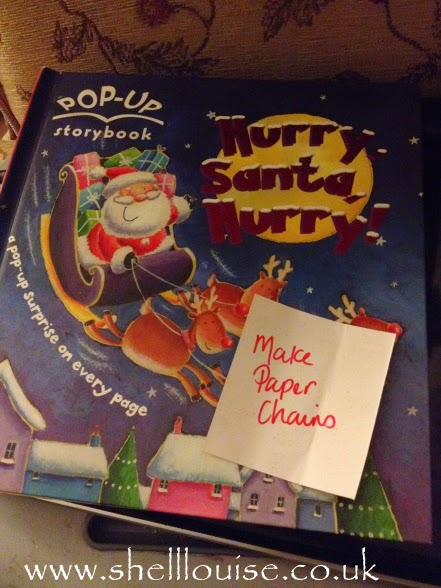 Book advent and activity advent - pop-up book called Hurry, Santa, Hurry! and the activity is to make paper chains