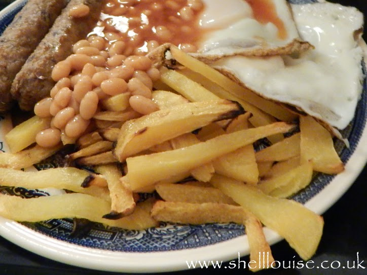 Swede chips, sausages, eggs and beans