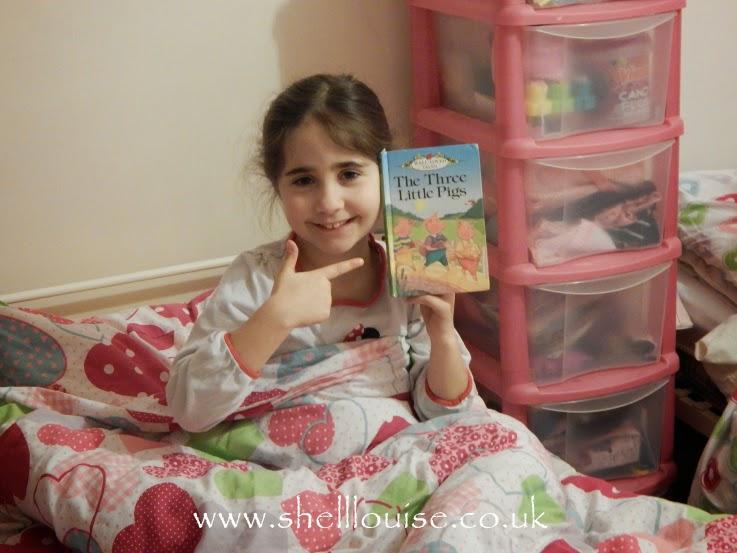 Ella reading the three little pigs
