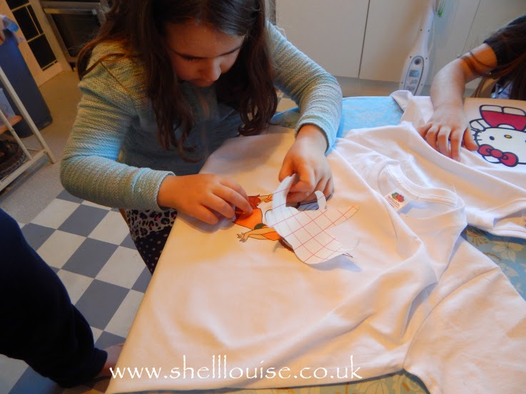 designing t-shirts - Kaycee peeling off her backing paper