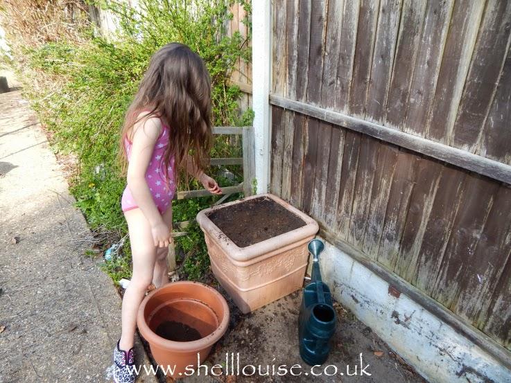Ella helping in the garden