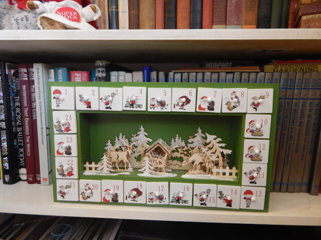 Wooden advent with drawers