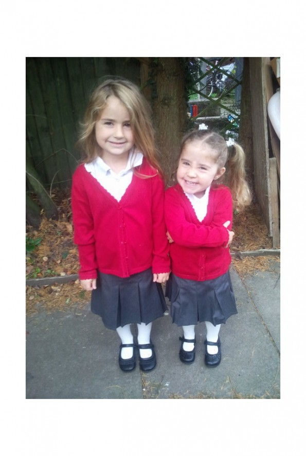Kaycee and Ella in school uniforms