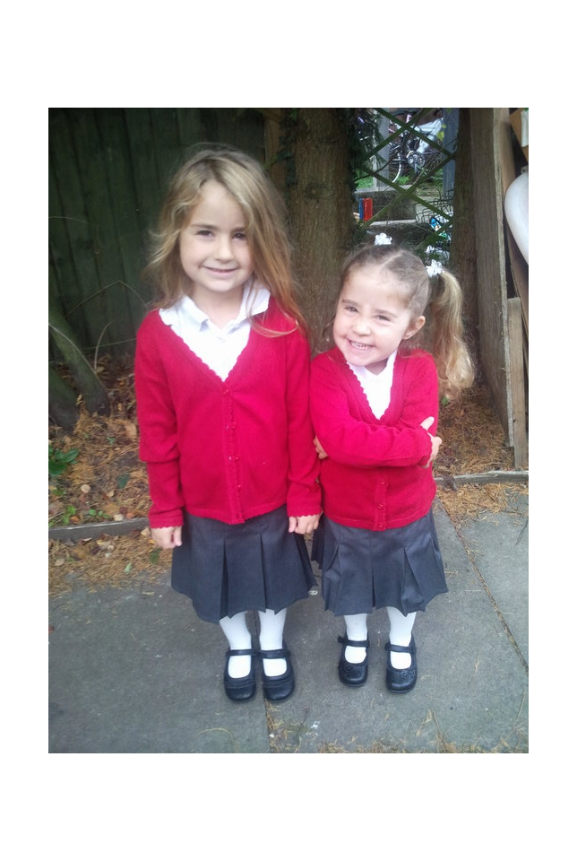 Kaycee and Ella in school uniforms