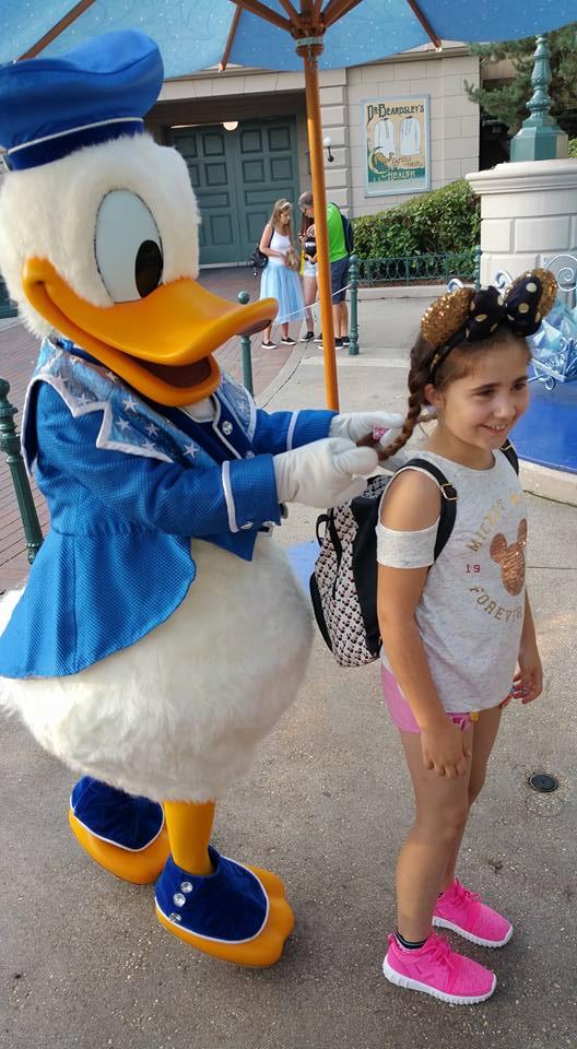 Donald Duck playing with Ella's hair - Disneyland Paris Photos
