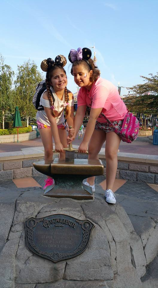 Kaycee and Ella trying to pull the sword from the stone - Disneyland Paris Photos
