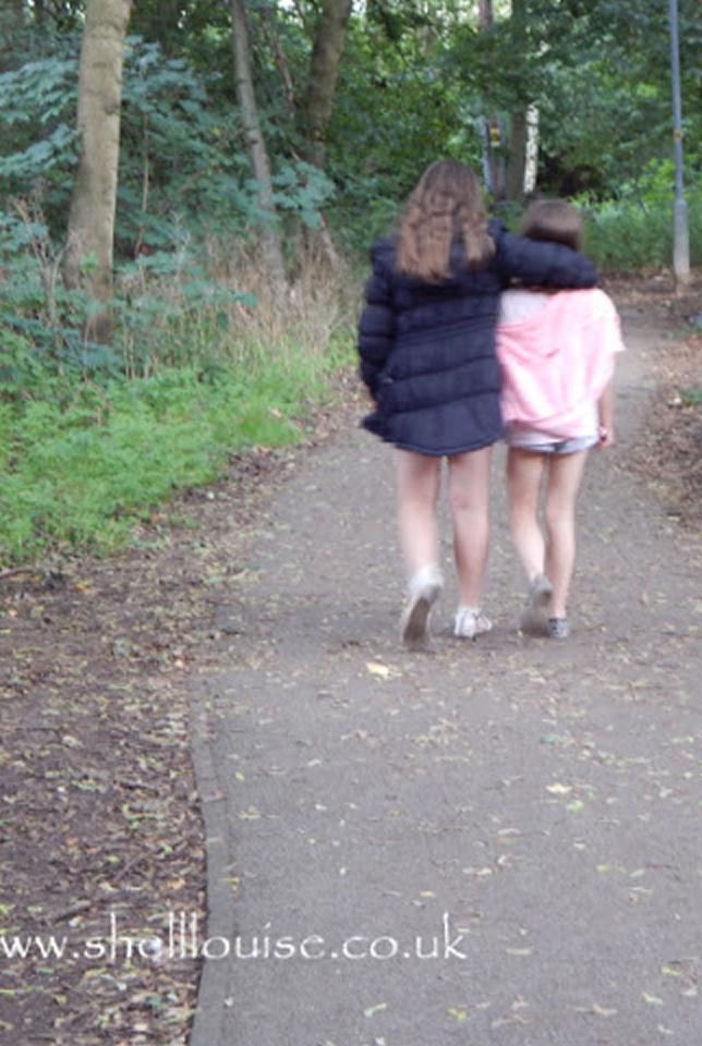 Kaycee and Ella walking in the woods
