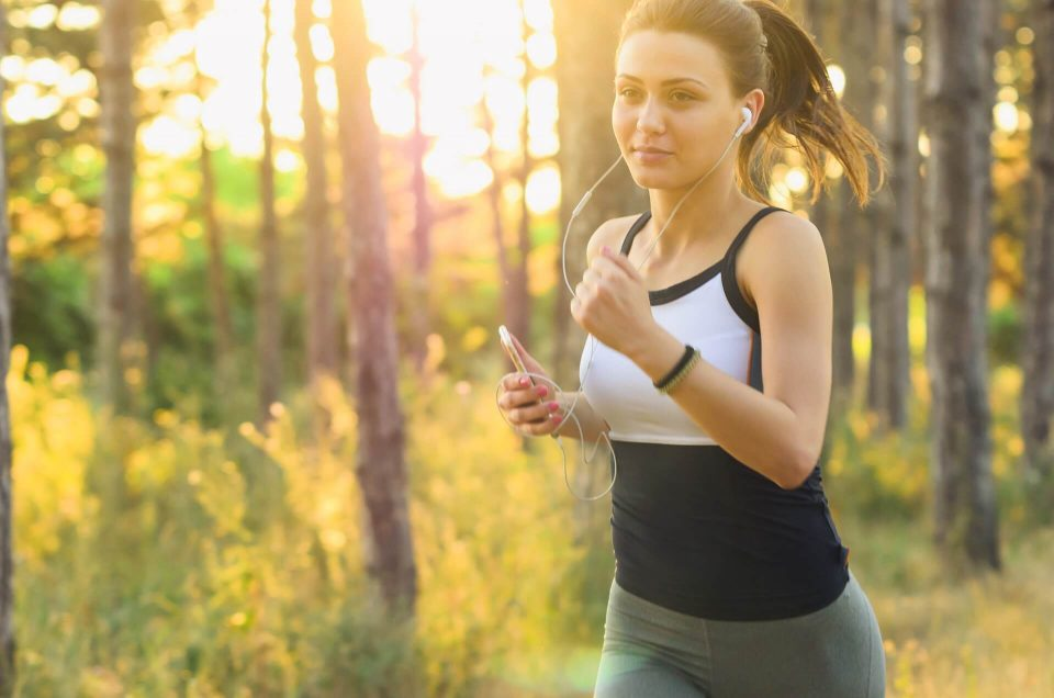 woman jogging in the wood