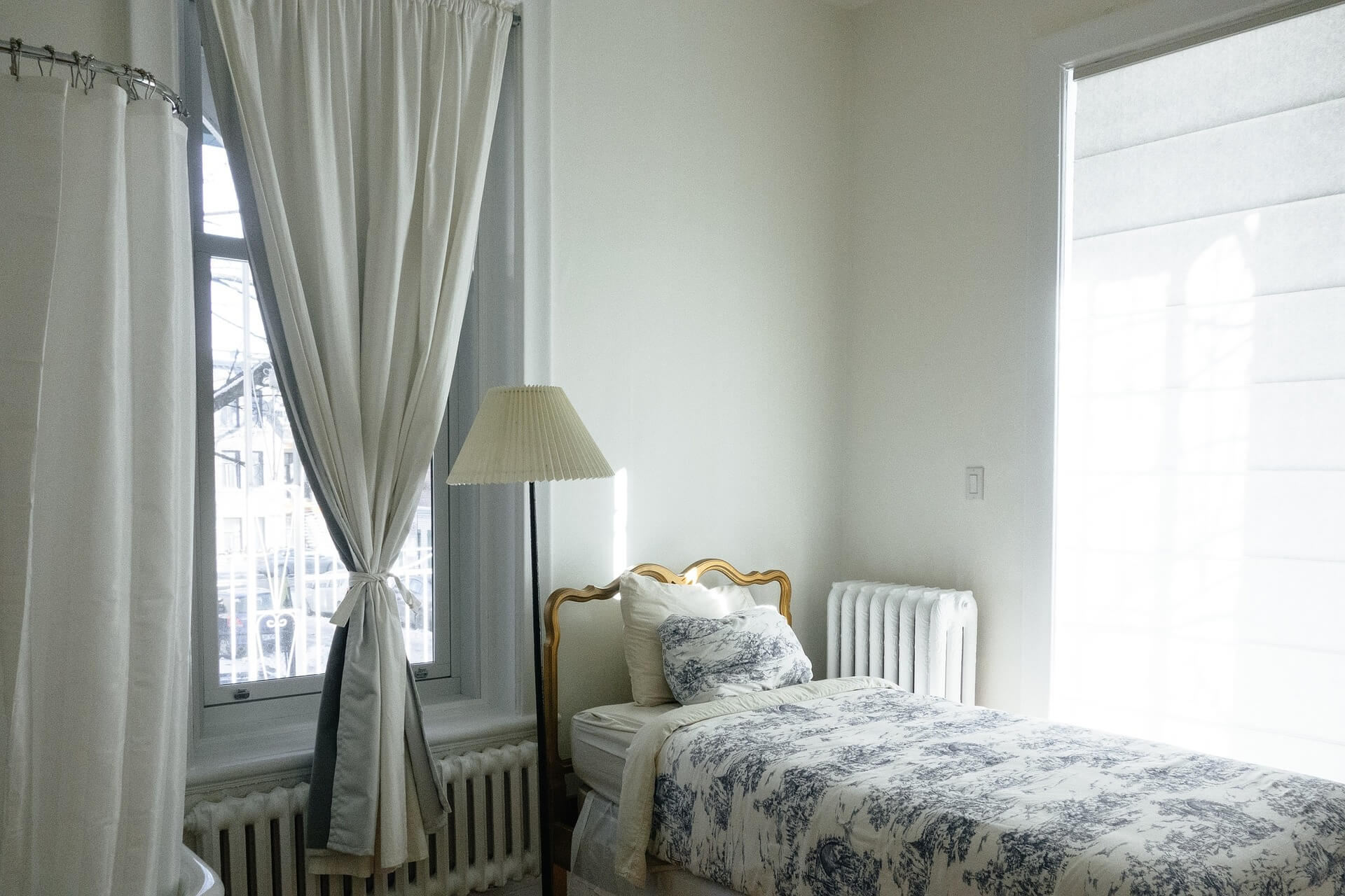 bedroom with curtains at the windows