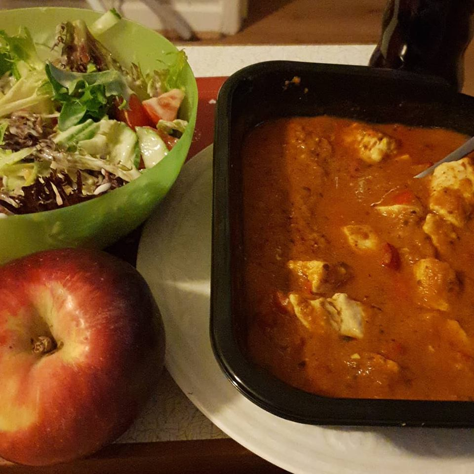 Chicken tikka ready meal with a side salad and followed by an apple for dinner.