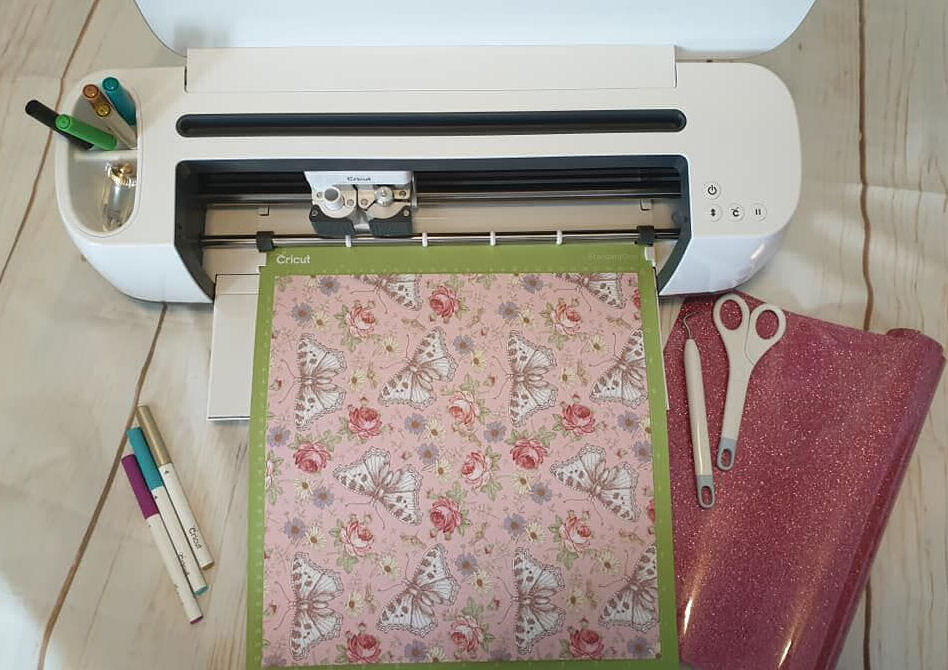 Cricut maker with loaded mat ready to go