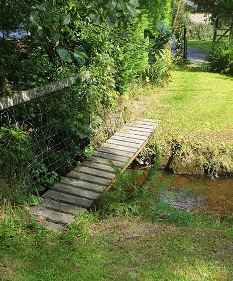bridge over the river at Felin Fach cottage, Pumsaint, Wales